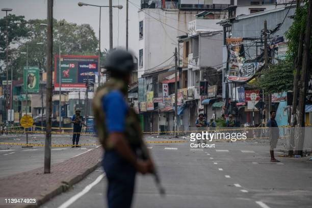 Sri Lankan Navy personnel guard a road block near the port on April 26 2019 in Colombo Sri Lanka The Sri Lankan Health Ministry revised the death...