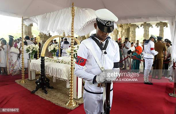 Sri Lankan Navy personnel keeps vigil alongside the coffin of legendary musician W D Amaradeva during his funeral at Independence Square in Colombo...