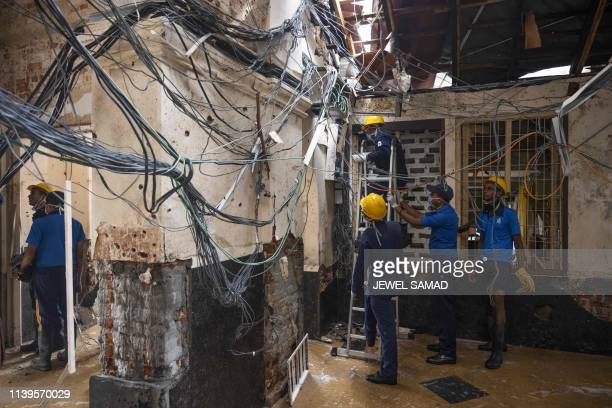 Sri Lankan Navy soldiers check electric lines inside St. Anthony's Shrine in Colombo on April 27 following a series of bomb blasts targeting churches...