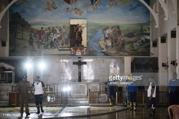 Sri Lankan navy soldiers work to clean St. Anthony's Shrine in Colombo on April 27 following a series of bomb blasts targeting churches and luxury...