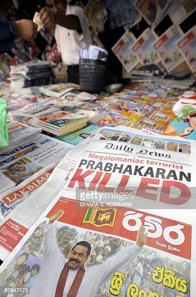 A Sri Lankan newspaper vendor displays newspapers with front pages announcing the death of Tamil Tiger leader Velupillai Prabhakaran marking the end...