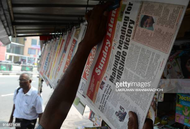 A Sri Lankan newspaper vendor sorts the Sunday papers in Colombo February 11 2018 Sri Lanka's ruling alliance was humiliated February 11 in local...