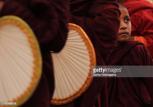 CONTENT] Sri Lankan novice monk looks on as Buddhist monks walk in line to participate the Jaya Piritha chanting programme in Colombo on May 9 2013...
