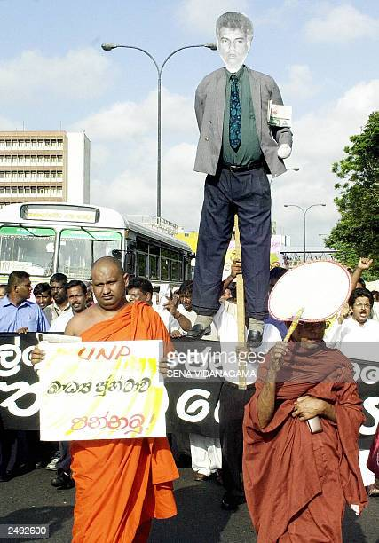 Sri Lankan opposition activists carry an effigy of Prime Minister Ranil Wickremesinghe during an antigovernment demonstration in the capital Colombo...