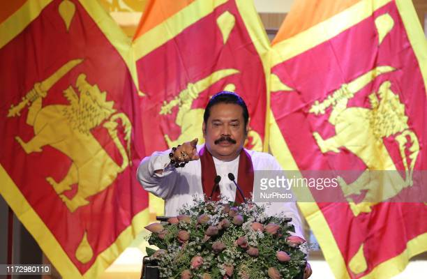 Sri Lankan opposition leader and former president Mahinda Rajapaksa speaks during an event to announce his brother, former defence secretary Gotabaya...