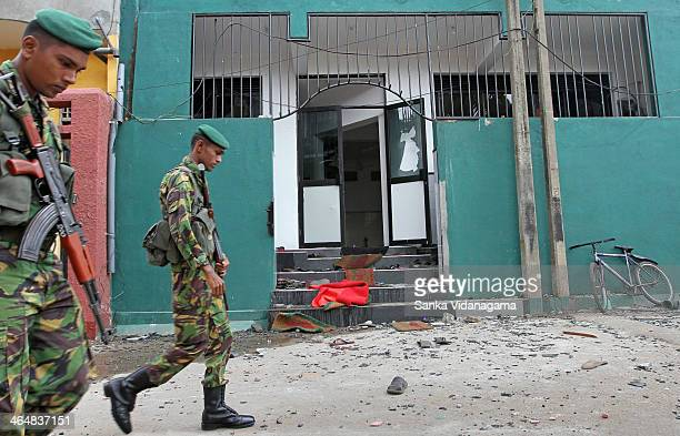 Sri Lankan para-military Special Task Force Commandos patrol outside a vandalized mosque in the capital Colombo on August 11 a day after a mosque was...