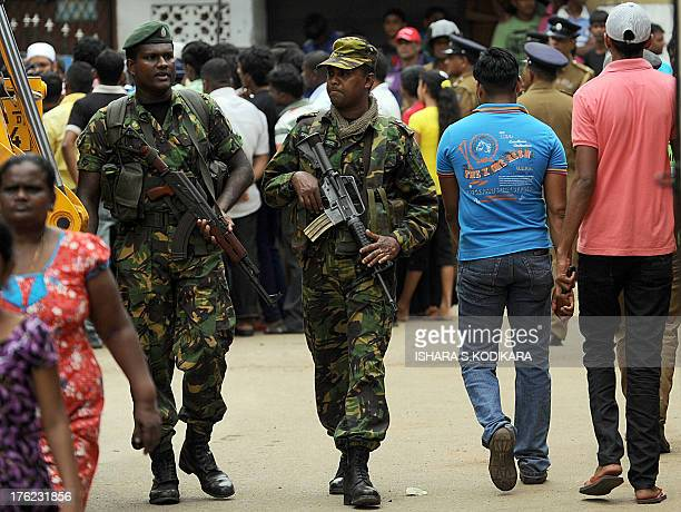Sri Lankan paramilitary Special Task Force commandos patrol outside the premises of a vandalized mosque in Colombo on August 12 2013 Local Buddhist...