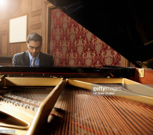 sri lankan pianist performing in nightclub - pianist front stock pictures, royalty-free photos & images