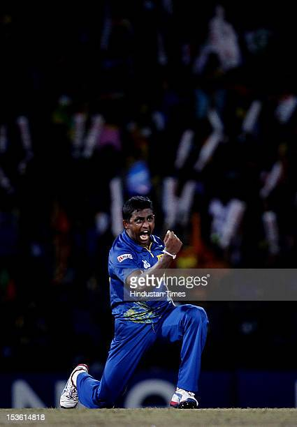 Sri Lankan player Ajantha Mendis celebrates the dismissal of West Indies player Andre Russell during the ICC World T20 Final between Sri Lanka and...