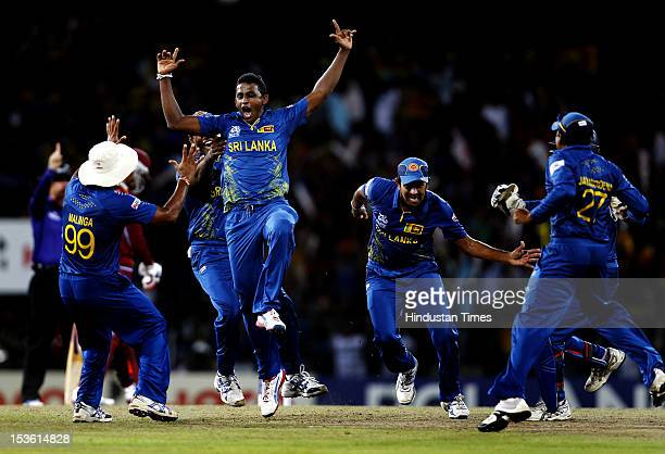 Sri Lankan player Ajantha Mendis celebrates the dismissal of West Indies player Chris Gayle during the ICC World T20 Final between Sri Lanka and West...