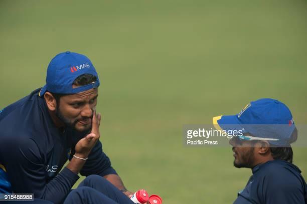 Sri Lankan player Dimuth Karunarathna applies sun cream on his face while having a chat with his team mate Dhanajaya de Silva during a training...