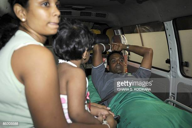 Sri Lankan player Thilan Samaraweera is taken aboard an ambulance March 04, 2009 accompanied by his wife, Manjula and their daughter, shortly after...