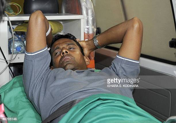 Sri Lankan player Thilan Samaraweera is taken aboard an ambulance on March 4 2009 shortly after flying home from Pakistan where the Sri Lankan team...