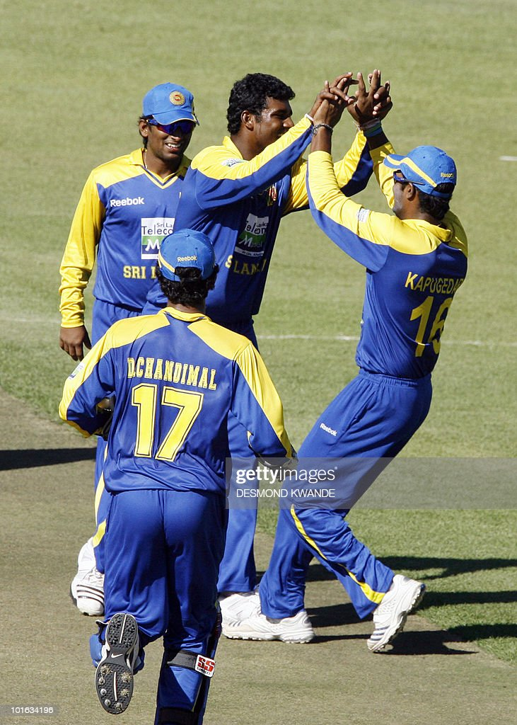 Sri Lankan players celebrate after Thissara Perera took the wicket of Indian batsman Dinesh Karthik at Harare Sports Club on June 5, 2010 in the fifth match of the Micromax Cup Triangular One-Day series hosted by Zimbabwe. AFP PHOTO / Desmond Kwande
