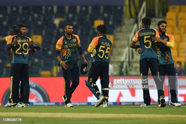 Sri Lankan players celebrate their victory over Ireland at the end of the ICC mens Twenty20 World Cup cricket match between Sri Lanka and Ireland at...