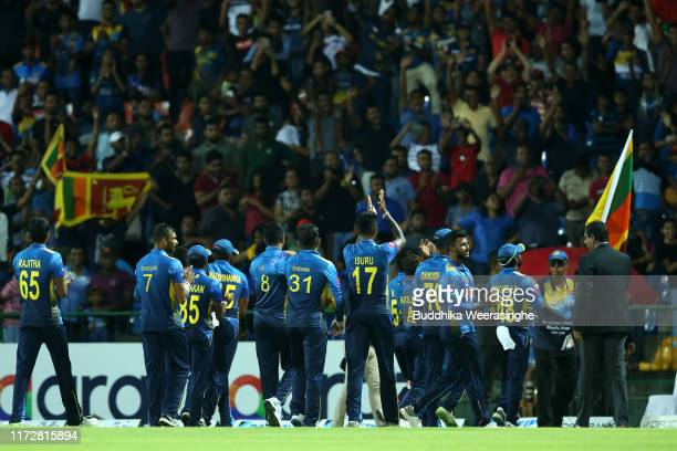 Sri Lankan players celebrate with fans after victory of 3rd day match during the Twenty20 International match between Sri Lanka and New Zealand at...