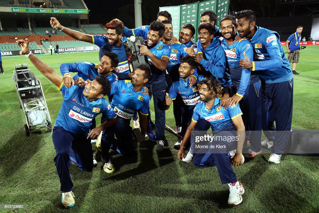 Sri Lankan players celebrate with their trophy after winning the series but losing the match during the International Twenty20 match between Australia and Sri Lanka at Adelaide Oval on February 22, 2017 in Adelaide, Australia.