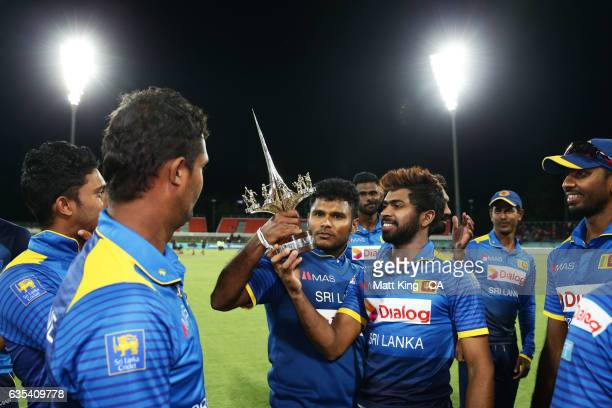 Sri Lankan players look at the Menzies Memorial Trophy after winning the T20 warm up match between the Australian PM's XI and Sri Lanka at Manuka...