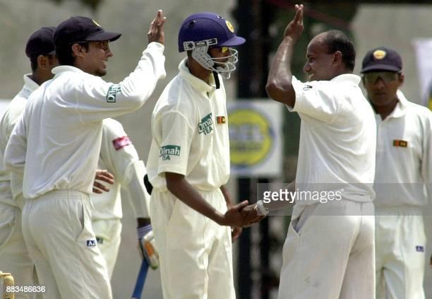 Sri Lankan players Mahela Jayawardena Russel Arnold and Kumar Sangakkara celebrate after Bangladeshi opening batsman Hannan Sarker was bowled out lbw...