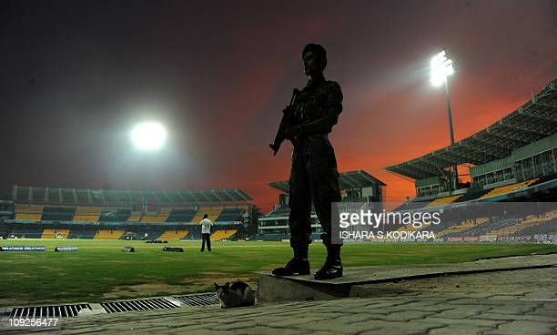 A Sri Lankan police commando stands guard at The R Premadasa stadium one of the venues for the ICC World Cup Cricket in Colombo on February 13...