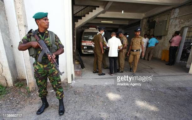 Sri Lankan Police Commando stands guard outside a police mortuary after identifying the body a day after multiple explosions targeting churches and...