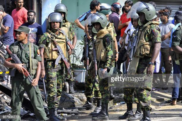 Sri Lankan police commandos patrol on the streets of Pallekele a suburb of Kandy on March 6 following antiMuslim riots that has prompted the...