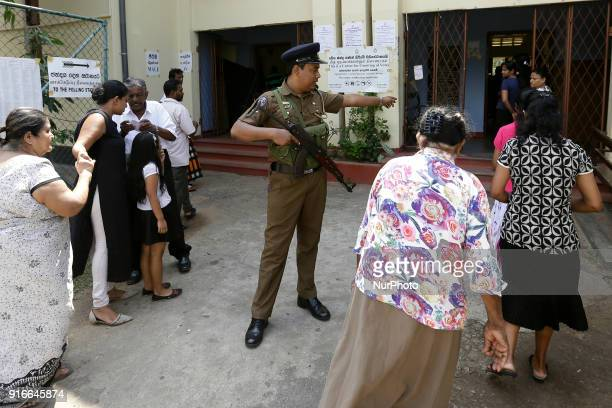 A Sri Lankan police officer directs the voters at a polling station in Colombo Sri Lanka on Saturday 10 February 2018