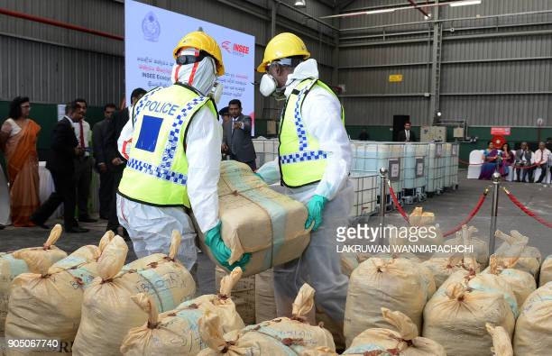 Sri Lankan police personnel prepare seized cocaine to be destroyed under judicial supervision in Katunayake on January 15 2018 Around a tonne of the...