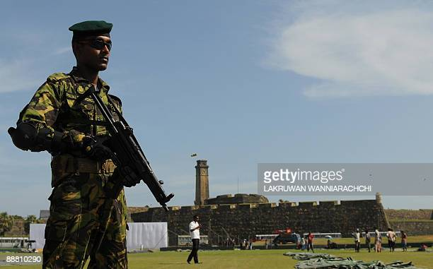 A Sri Lankan Police Special Task Force commando stands guard during Pakistani cricket team practice session at The Galle International Cricket...