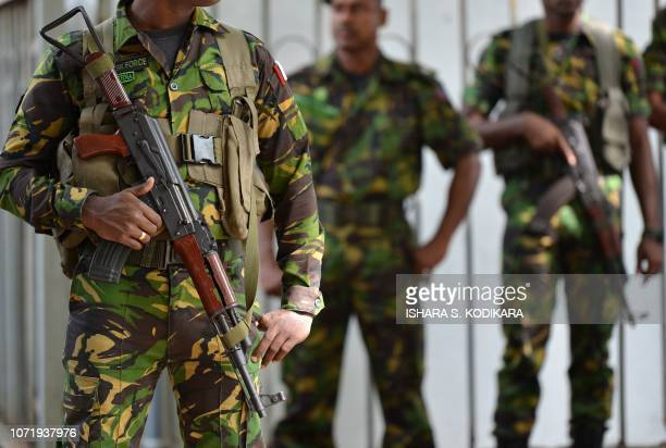 Sri Lankan Police Special Task Force soldiers stand guard near the Sri Lankan Supreme Court in Colombo on December 12 2018 Sri Lanka's ousted prime...