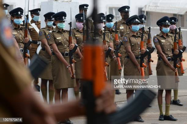Sri Lankan police women wearing a facemask as a preventive measure against the spread of the COVID19 coronavirus take part in a rehearsal parade in...