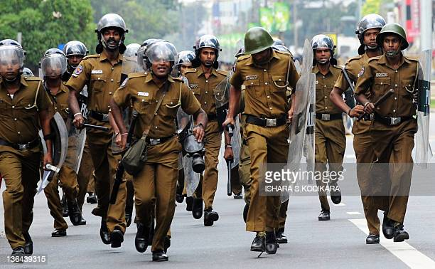Sri Lankan policemen arrive at a university students protest in Colombo on January 5, 2011. Students were asking authorities to remove vice...