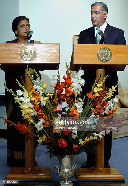 Sri Lankan President Chandrika Kumaratunga looks on as Pakistani Prime Minister Shaukat Aziz answers a question during a press briefing after their...