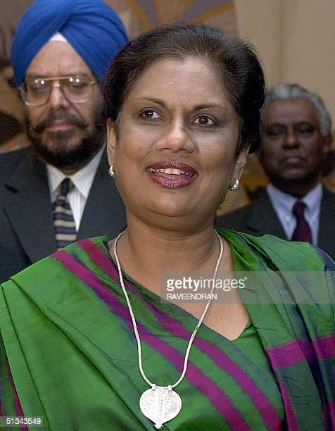 Sri Lankan President Chandrika Kumaratunga speaks to journalists on her arrival at the Indira Gandhi International Airport in New Delhi 22 February...