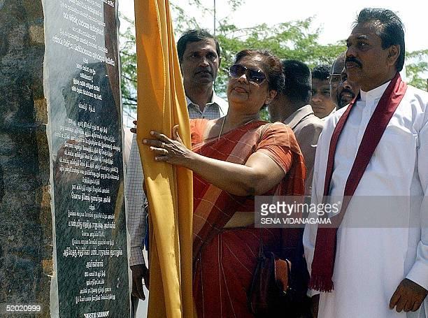 Sri Lankan President Chandrika Kumaratunga stands beside Prime Minister Mahinda Rajapakse in Hambantota 19 January 2005 Kumaratunga has launched Sri...