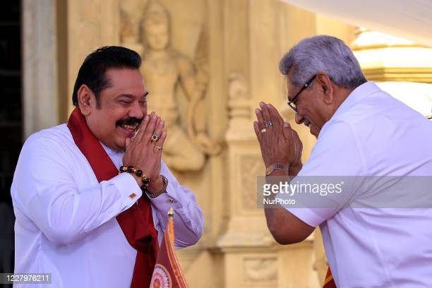 Sri Lankan president Gotabaya Rajapaksa greets after handing over the appointment documents to his brother, former president, Mahinda Rajapaksa who...