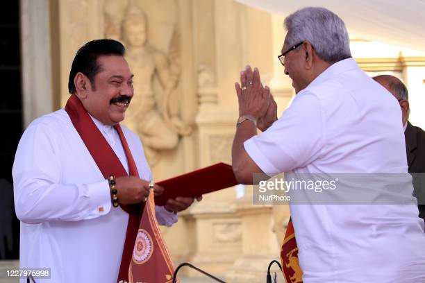 Sri Lankan president Gotabaya Rajapaksa hands over the appointment documents to his brother, former president, Mahinda Rajapaksa who took oaths as...