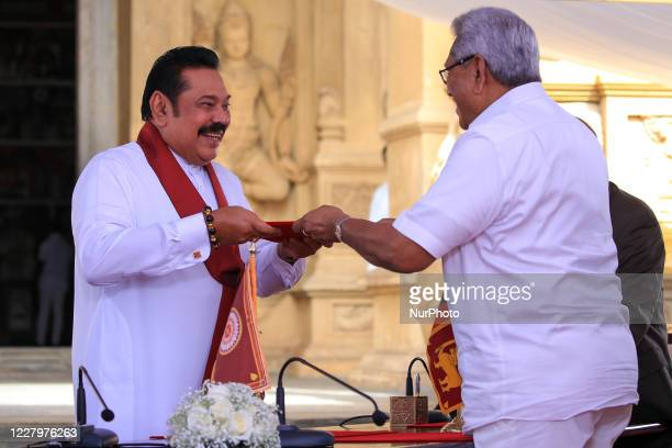 Sri Lankan president Gotabaya Rajapaksa hands over the appointment documents to his brother, former president, Mahinda Rajapaksa after taking oaths...