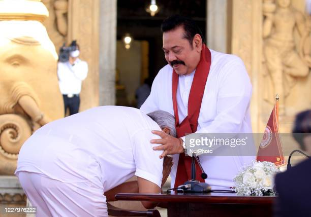 Sri Lankan president Gotabaya Rajapaksa receives blessings after handing over the appointment documents to his brother, former president, Mahinda...