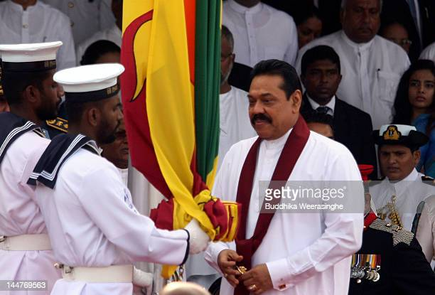 Sri Lankan president Mahinda Rajapaksa hoists the national flag to commemorate the third anniversary of the end of the civil war on May 19 2012 in...