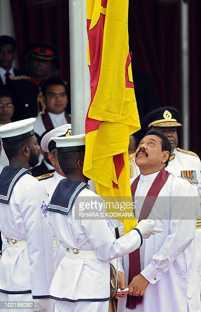 Sri Lankan President Mahinda Rajapakse hoists the national flag during the victory day parade in Colombo on June 18 2010 Sri Lanka staged a delayed...