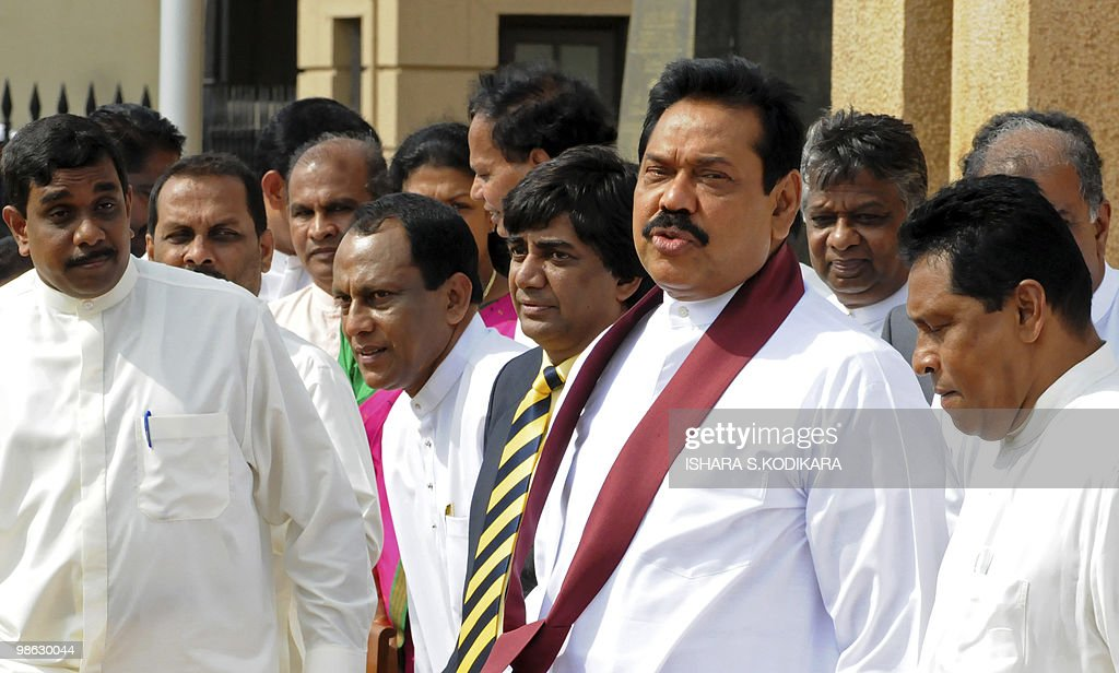 Sri Lankan President Mahinda Rajapakse is seen in the company of his new deputy ministers in Colombo on April 23, 2010. Sri Lanka's new Cabinet was sworn in by Sri Lankan President Mahinda Rajapakse folowing his parliamentary election win on April 8. AFP PHOTO/ Ishara S