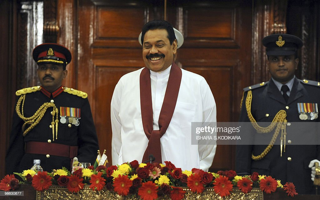 Sri Lankan President Mahinda Rajapakse (C) looks on during the new cabinet ministers' ceremony in Colombo on April 23, 2010. Sri Lanka's new Cabinet was sworn in by Sri Lankan President Mahinda Rajapakse folowing his parliamentary election win on April 8. AFP PHOTO/ Ishara S