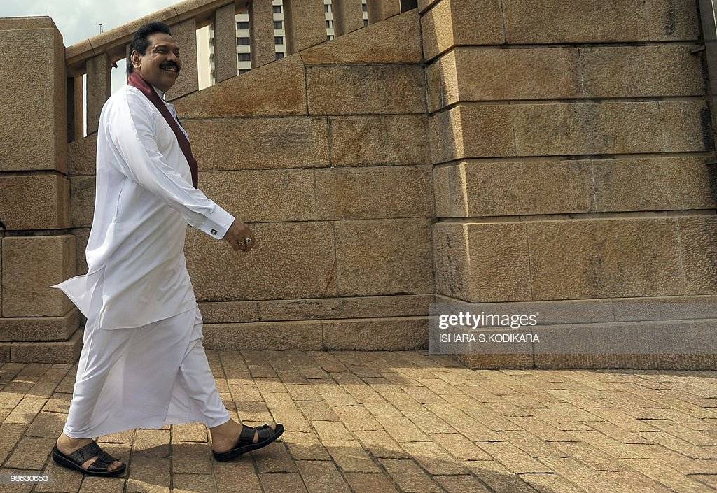 Sri Lankan President Mahinda Rajapakse walks outside the parliament building following a swearing in ceremony in Colombo on April 23, 2010. Sri Lanka's new Cabinet was sworn in by Sri Lankan President Mahinda Rajapakse folowing his parliamentary election win on April 8. AFP PHOTO/ Ishara S