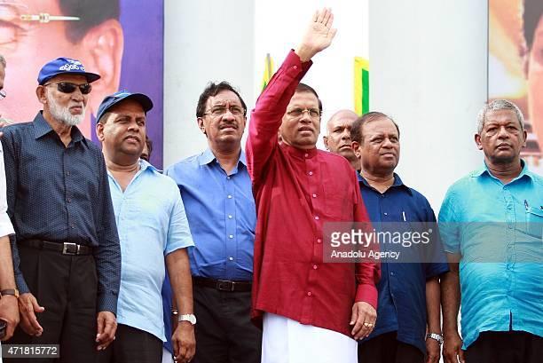 Sri Lankan President Maithripala Sirisena acknowledges the crowd during a May Day rally in Colombo Sri Lanka Friday May 1 2015