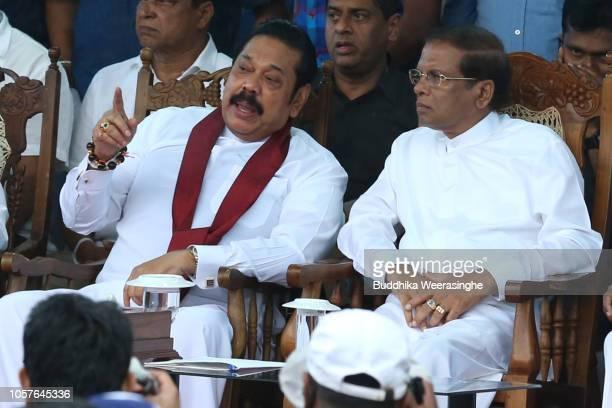 Sri Lankan President Maithripala Sirisena and newly appointed Prime Minister Mahinda Rajapakse talk during a public rally on November 5 2018 in Sri...