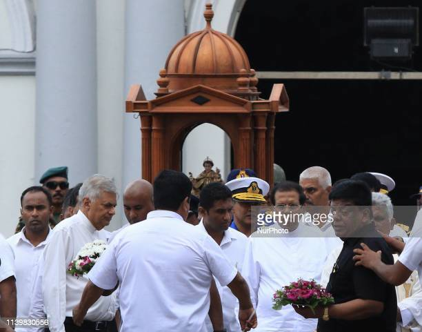 Sri Lankan President Maithripala Sirisena and prime minister Ranil Wickremesinghe arrive at St Anthony's Church where an explosion took place one...