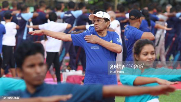 Sri Lankan president Maithripala Sirisena performs Yoga during an event to mark the International Yoga Day at the Independence Square Colombo Sri...