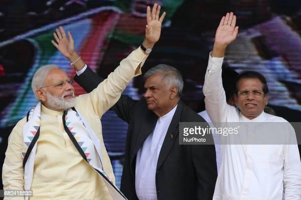 Sri Lankan President Maithripala Sirisena Right Indian Prime Minister Narendra Modi and Sri Lankan Prime Minister Ranil Wickremesinghe wave to Sri...