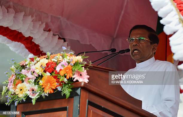 Sri Lankan President Maithripala Sirisena speaks outside of the Buddhist Temple of Tooth in the central town of Kandy on January 11 2015 Sri Lanka's...